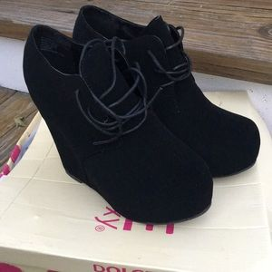 Adorable black wedge booties. Brand new with box